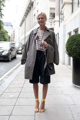 She balanced tomboy bermuda shorts and a menswear coat with the prettiest kind of ankle-strap sandals.