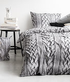 Nothing says cool temperatures and cozy nights like knit-printed bedding ($18).