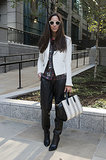 She knows her way around a cool-girl mix, from her frames, to her tweedy jacket, leather pants, and Alexander Wang bag, this look screams on-trend.