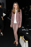 Olivia Palermo was sleek and chic in a pair of dusty-rose leather pants and a matching blazer at the Anya Hindmarch show in London.