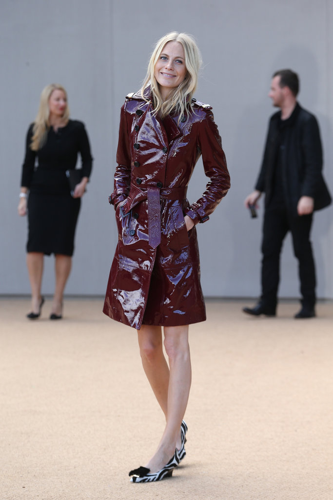 Poppy Delevingne didn't need much more than a red patent trench coat to shine outside Burberry Prorsum.
