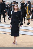 Olivia Palermo ditched color and stuck to black at Burberry Prorsum. She did add pops of bright via her printed clutch and ankle-strap sandals.