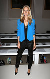 Poppy Delevingne's bold blue blazer brightened up her black pieces at the Pinghe show at London Fashion Week.