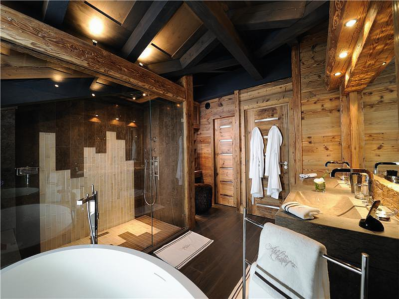 No need to head to the spa when you have your own personal sauna, soak tub, and a shower bigger than most bathrooms. Is it safe to assume that those towel racks are heated?  Source: Sotheby's Realty