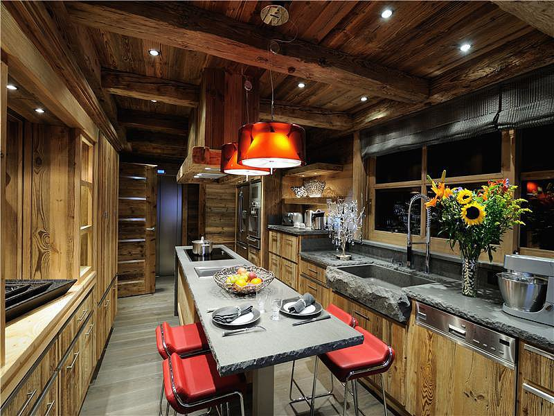 Rustic meets modern for a kitchen that would significantly upgrade our cup of coffee each morning.  Source: Sotheby's Realty