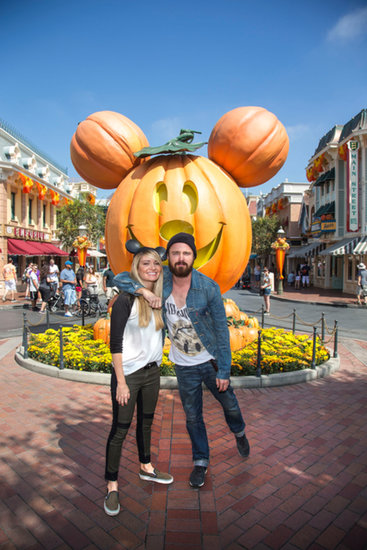 Aaron Paul and his wife, Lauren Parsekian, got into the spirit at Disneyland for their Halloween celebrations in September 2013.