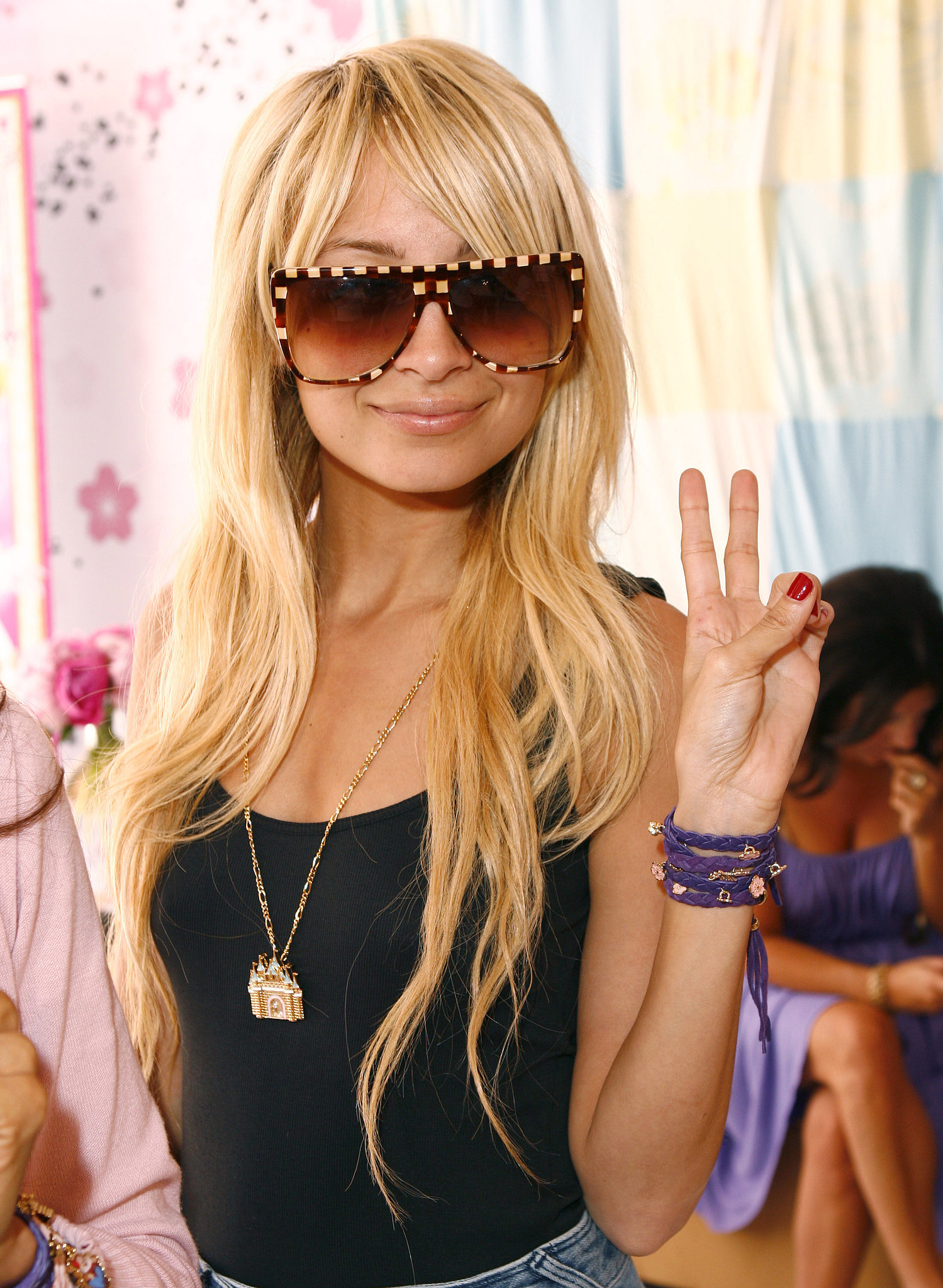 She flashed a peace sign at a Disney Couture party hosted by her longtime friend Kidada Jones in May 2007.