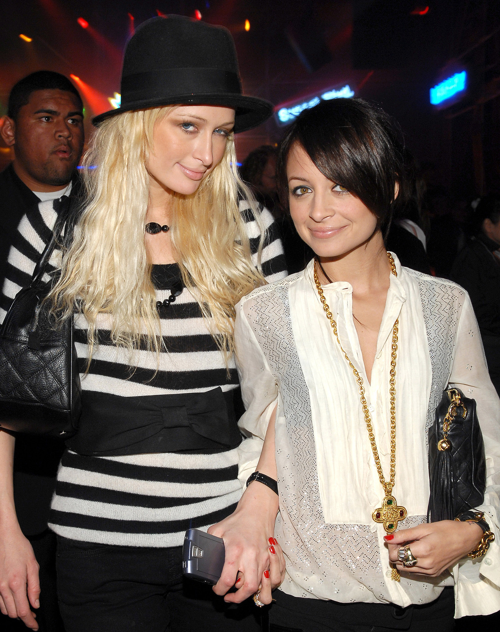 A dark-haired Nicole stuck close to her pal Paris Hilton during an LA soirée in November 2006.
