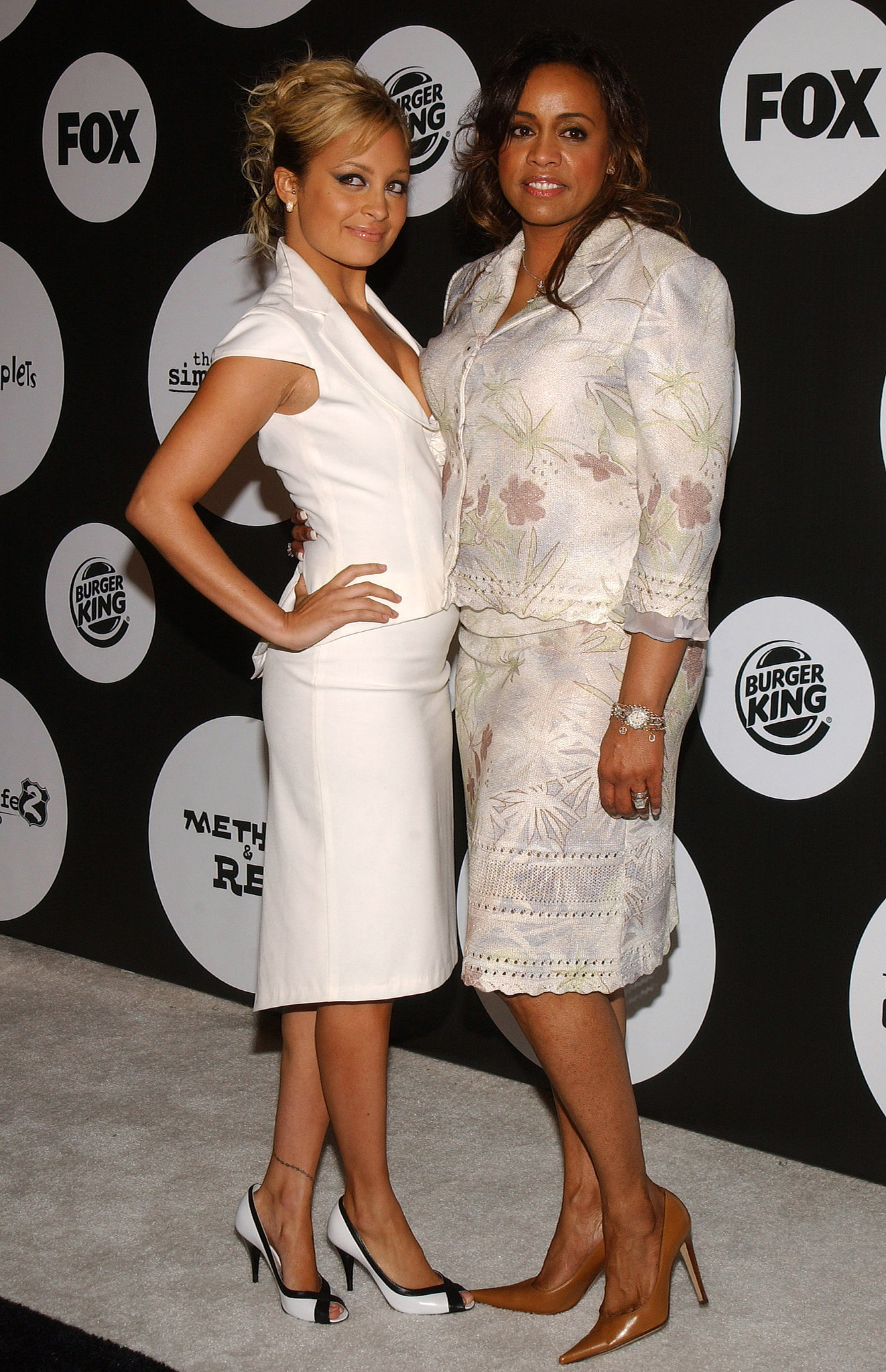 Nicole Richie went for a mature suited-up look while attending a Fox event with her mom, Brenda, in June 2004.