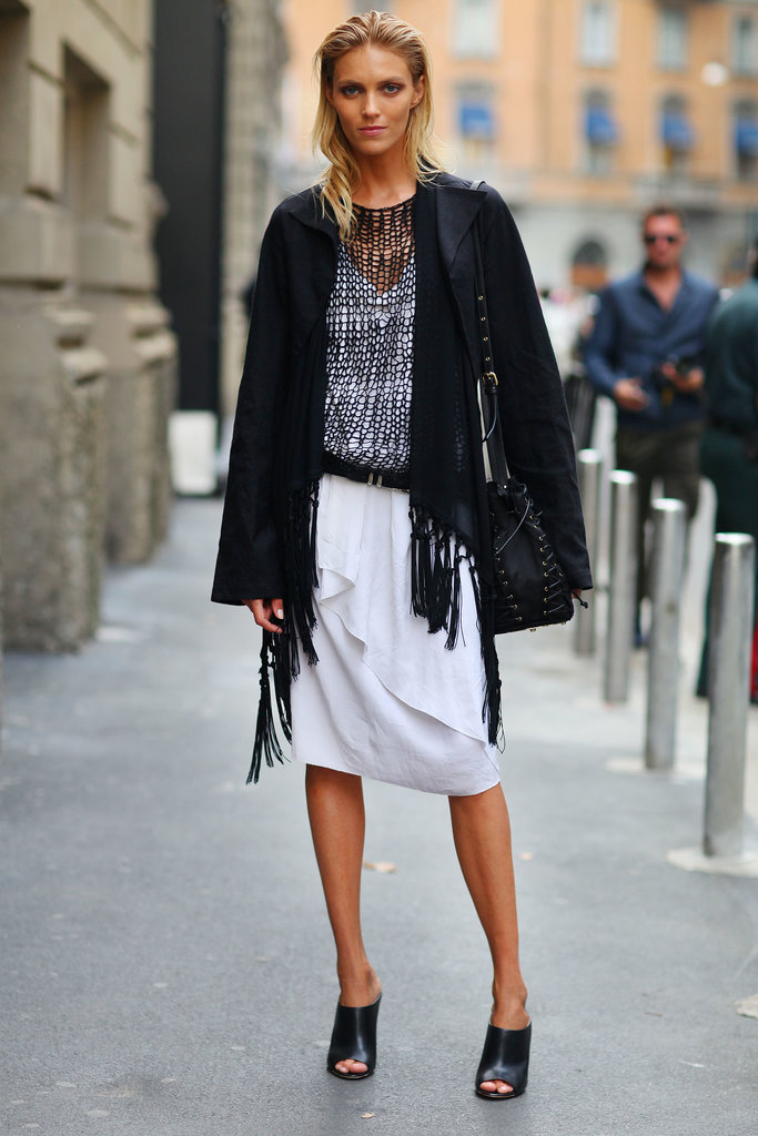 Anja Rubik layered up in an open knit, and polished off her black and white look with mules.