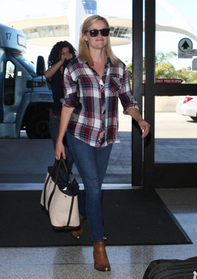 Reese Witherspoon matched her plaid Rails blouse with skinny denim and tan boots at LAX airport.