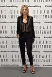 Kate Moss wore a black suit and sheer blouse.