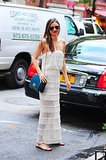 Clearly a fan of sheer this week, the former Victoria's Secret model punctuated a sheer-panel maxi dress and simple sandals with a teal Emilio Pucci bag while out and about in New York City..