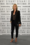 Kate Moss stepped out for Stuart Weitzman at the label's Milan store opening.