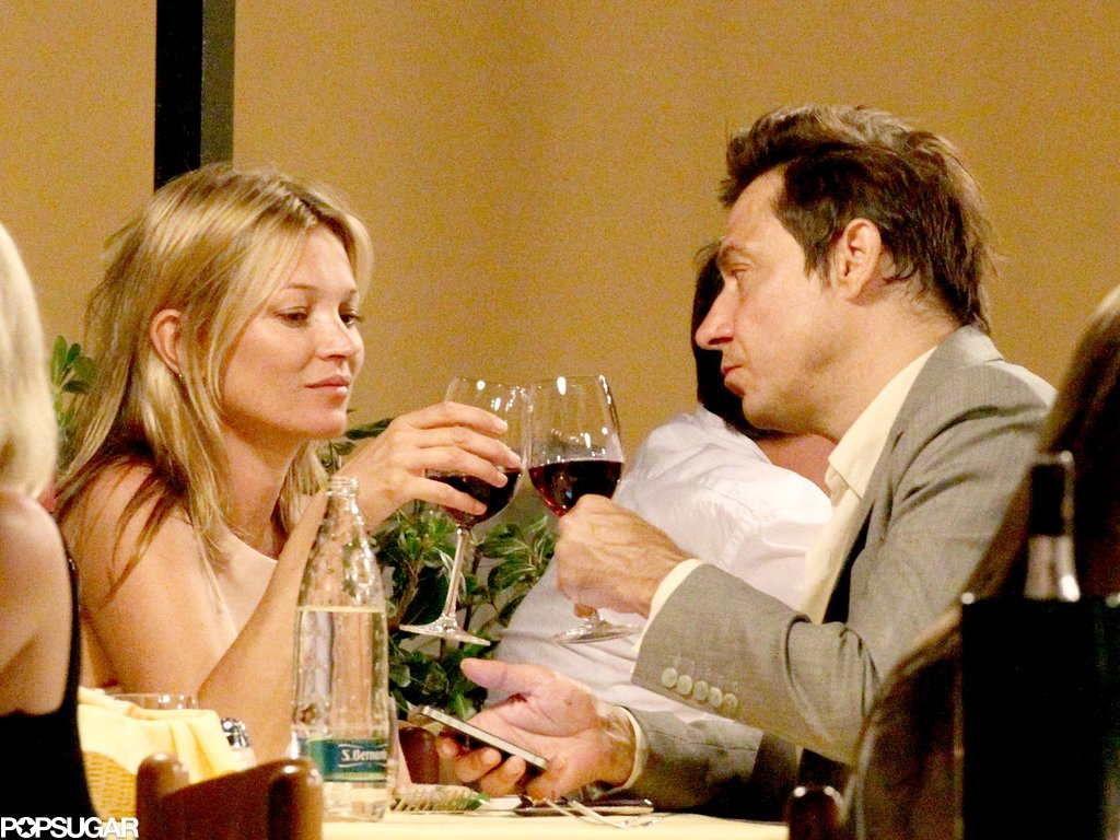Kate Moss and Jamie Hince toasted with glasses of wine during their romantic dinner in Portofino.