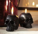 Create a dark and dim space by lighting these skull candles ($10) throughout your (haunted) house.
