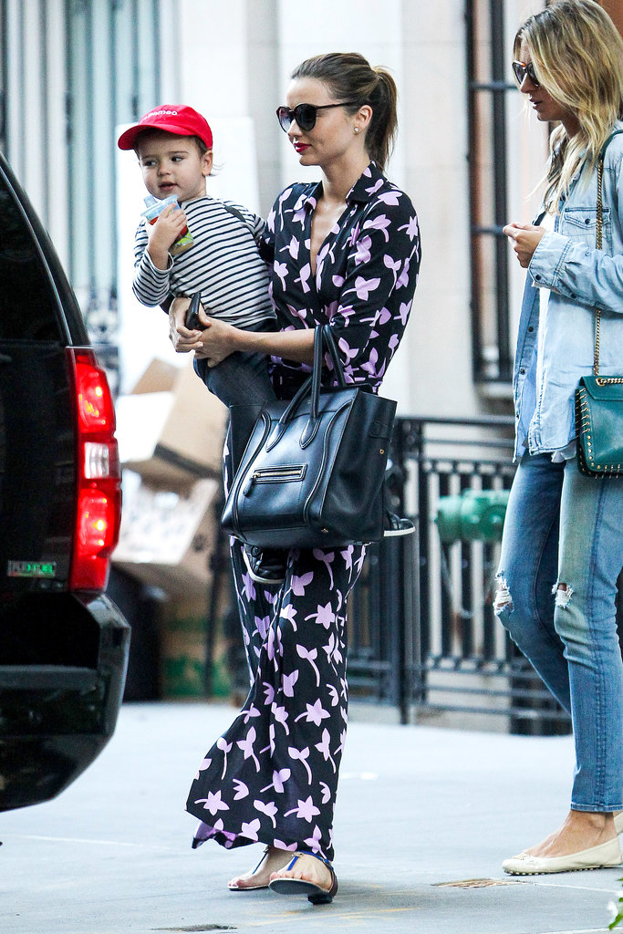 Miranda pulled on a pair of blue T-bar sandals and a printed Diane von Furstenberg wrap dress while running errands in New York with her son, Flynn.