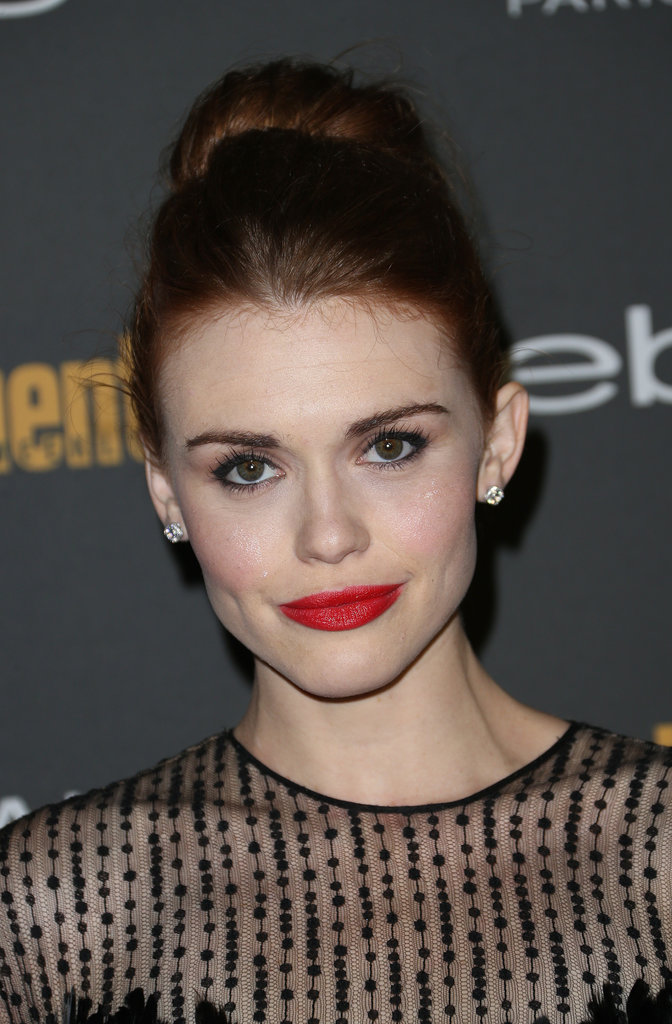 Holland Roden coupled a matte red lip with a high topknot at Entertainment Weekly's pre-Emmys party.