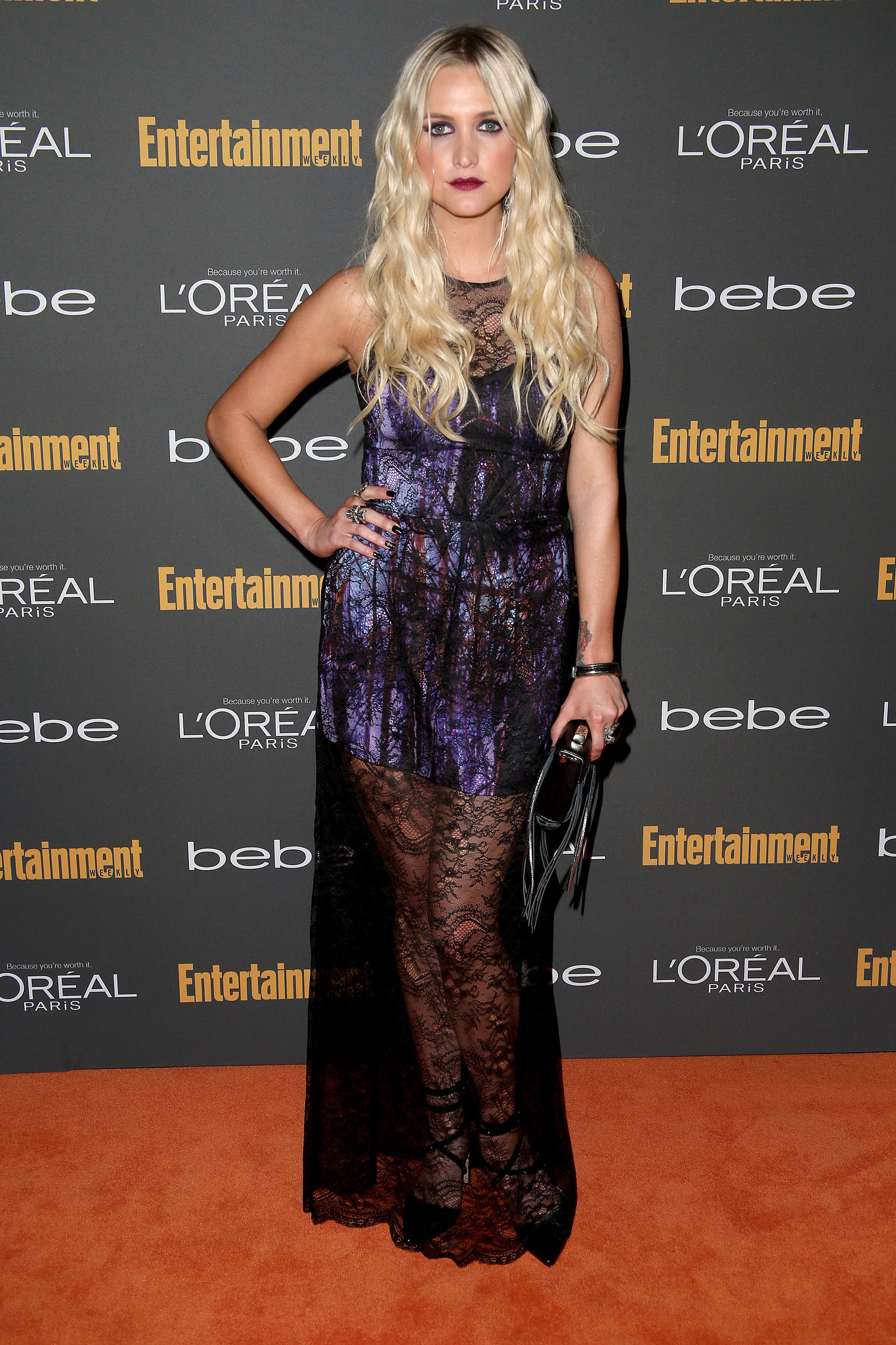 Ashlee Simpson kept it goth in a printed dress with a black l