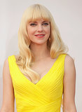 Obviously, Anna Faris was inspired by the bombshell beauties of yore for her beauty look. Her pinup-style waves and thick eyeliner were made more modern with an orange lipstick and blunt bangs.