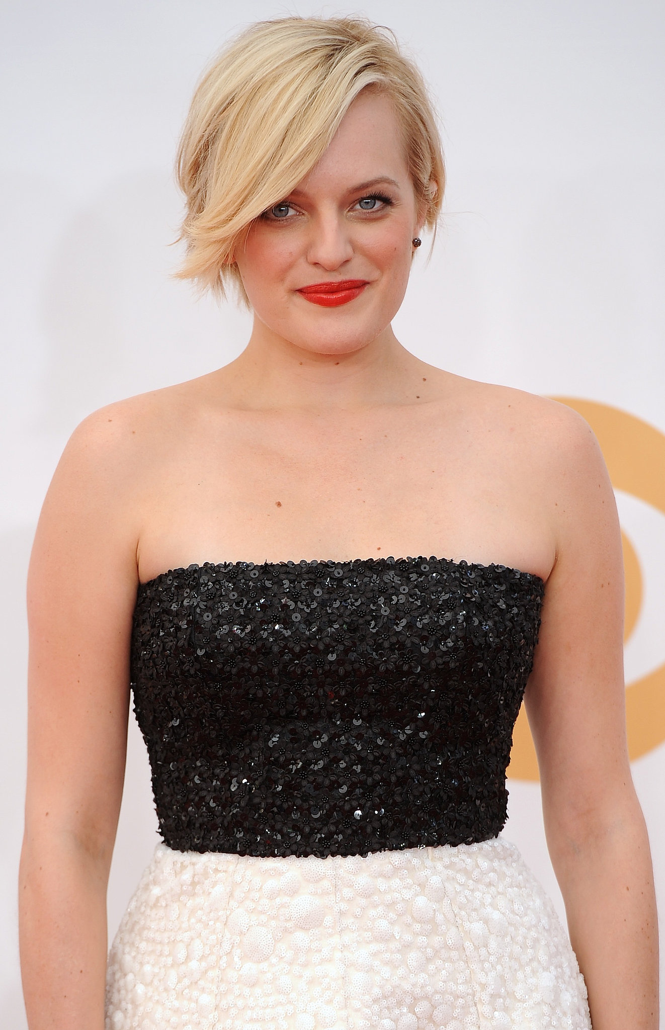 This tomato-red lipstick on Elisabeth Moss provided just the right amount of color to pair with her platinum coif and black and w