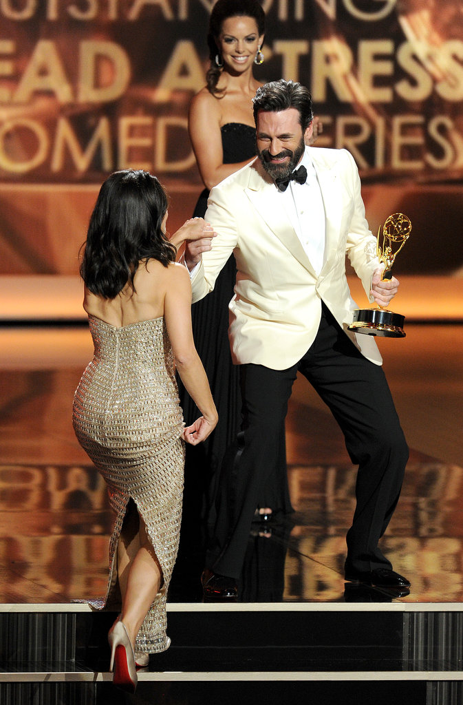 Jon Hamm helped Julia Louis-Dreyfus onto the stage to accept her award.