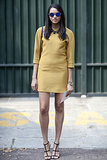 A basic mustard dress is the perfect canvas for a statement necklace and cage heels.