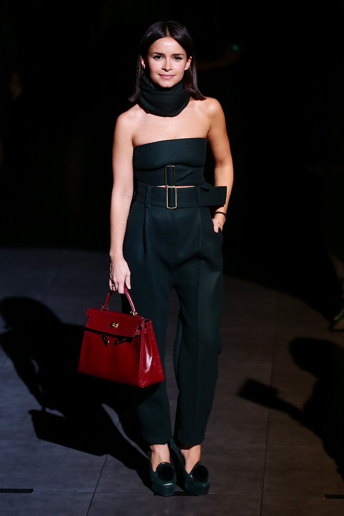 Miroslava Duma brightened up her black ensemble with a rich red tote at the Dolce & Gabbana runway show in Milan.