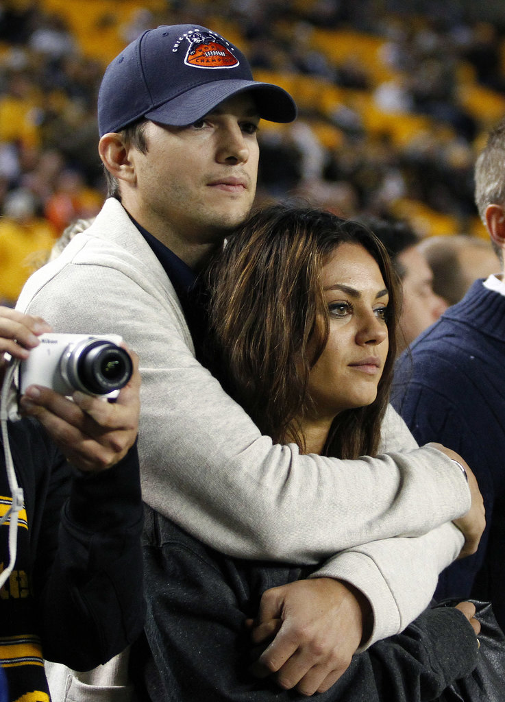 Ashton Kutcher and Mila Kunis cuddled up as the Chicago Bears played the Steelers in Pittsburgh on Sunday.