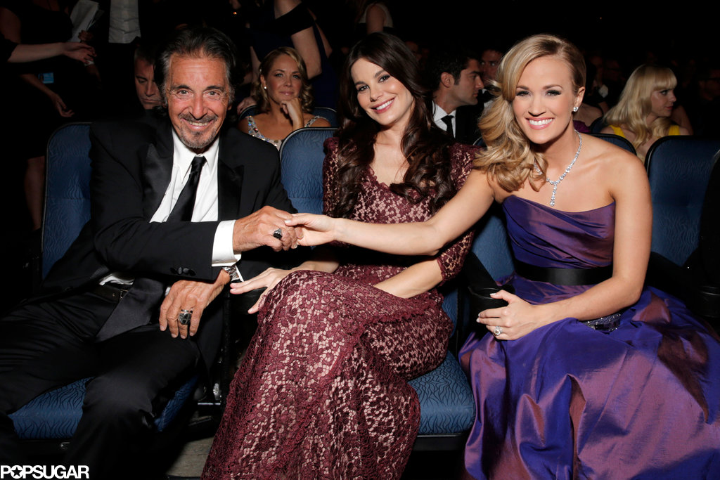 How's this for a random meetup? Al Pacino and his girlfriend, Lucila Sola, had a touching moment with Carrie Underwood as they took their seats in the Emmys audience.