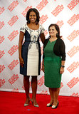 Michelle Obama looked lovely in a navy-and-white floral dress and gray slingback pumps at a first ladies lunch at the Studio Museum in Harlem in NYC.