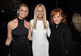 Gwyneth Paltrow hooked up with country stars Faith Hill and Reba McEntire at the LA screening of her film Country Strong in December 2010.