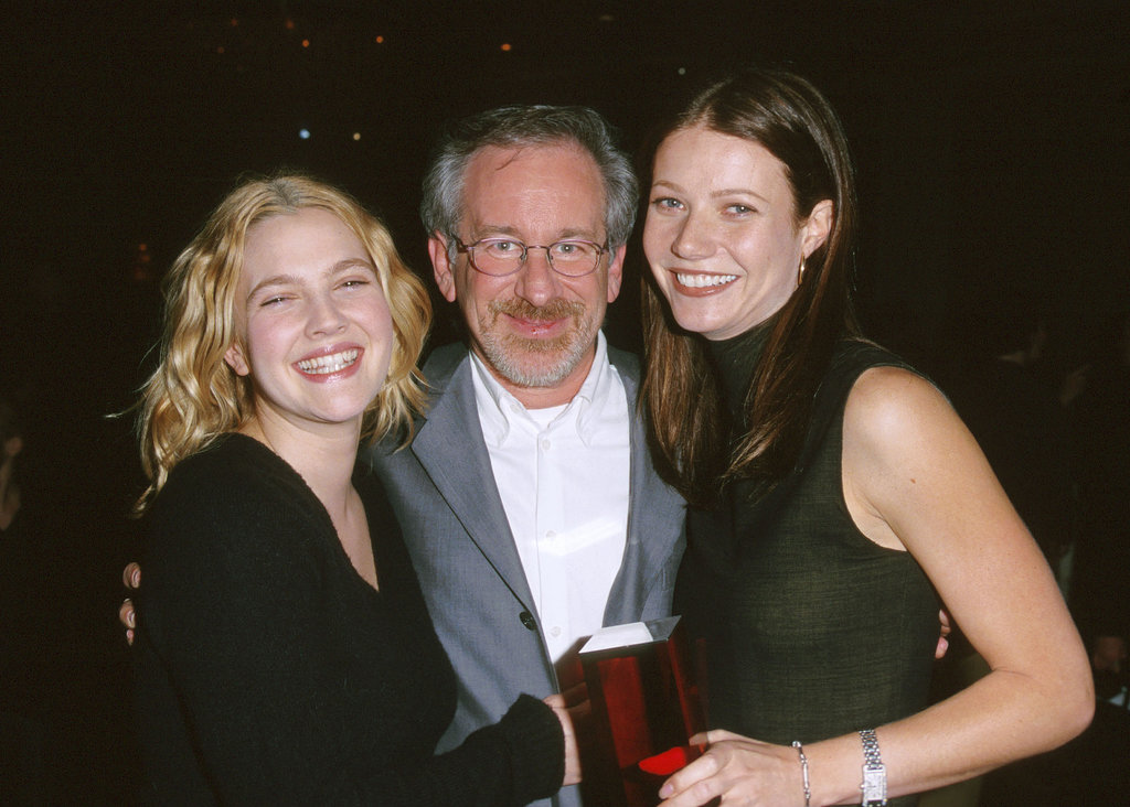 Gwyneth Paltrow and Drew Barrymore met up with their godfather, Steven Spielberg, at a Hollywood luncheon in November 1999.