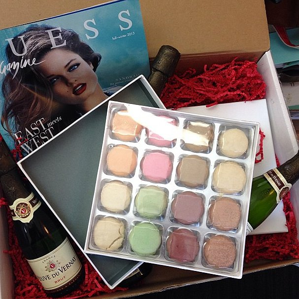 Guess delivered the perfect treats: champagne and macarons!