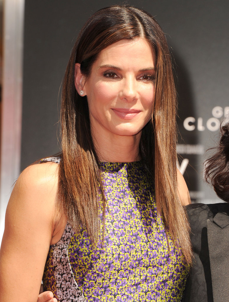 Celebrating her new film Gravity with handprints at the TCL Chinese Theatre, Sandra Bullock dressed for the occasion with straightened locks with a diagonal part and soft taupe eye shadow.