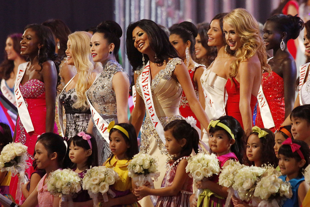 The Miss World contestants sang with a group of children during the pageant.