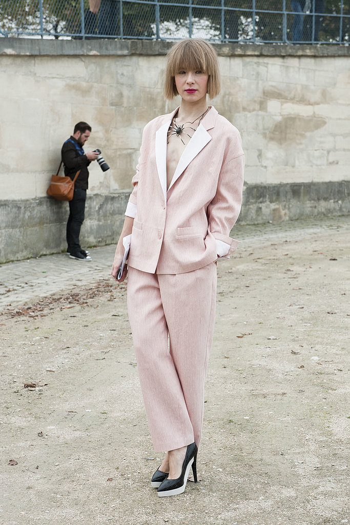 A pretty pink suit with a delicate but fierce necklace.