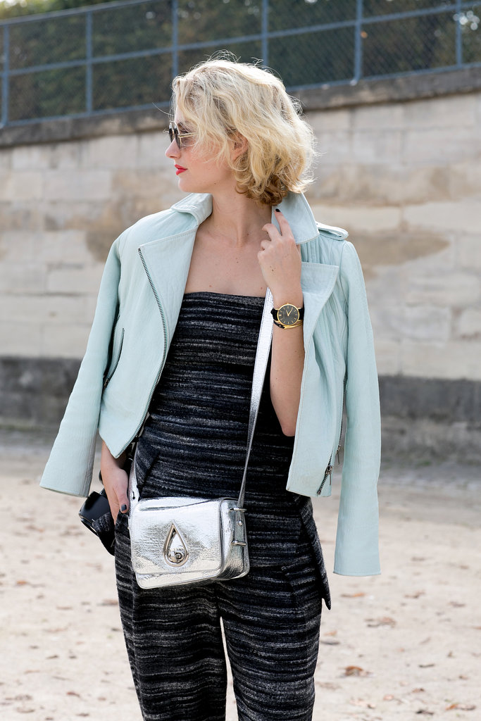 A metallic bag gives this jumpsuit an accessory upgrade.