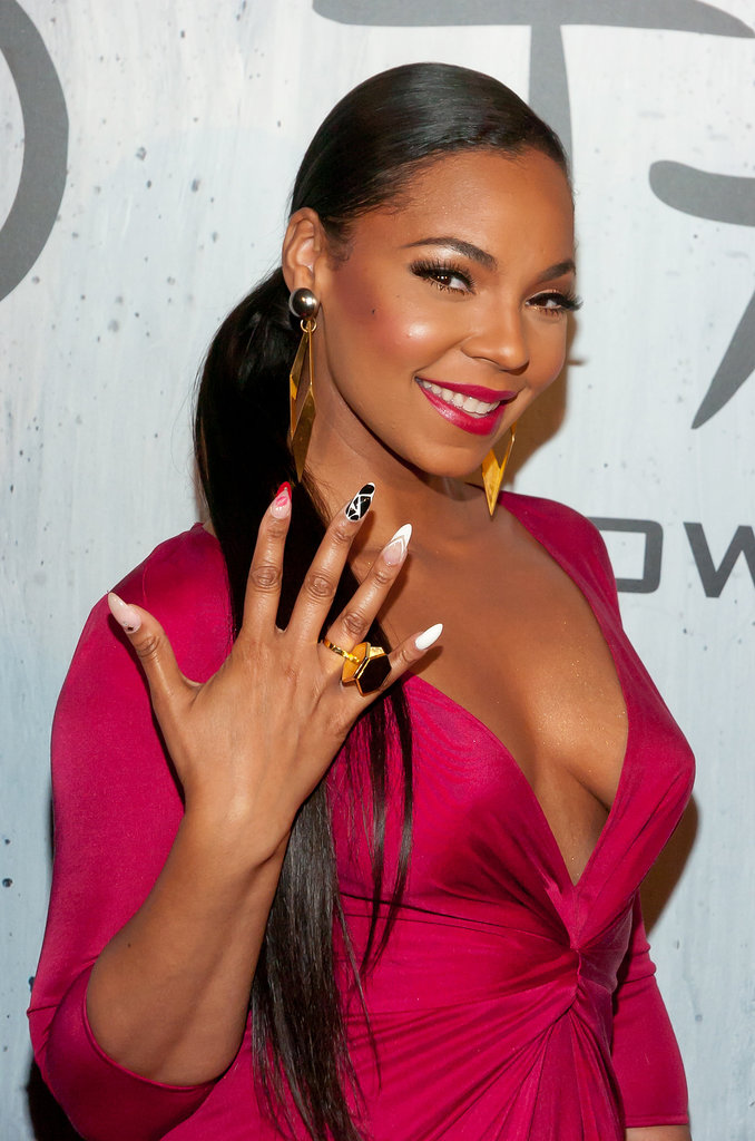 With a polished side ponytail and berry lipstick hue, Ashanti showed off her playful nail art.