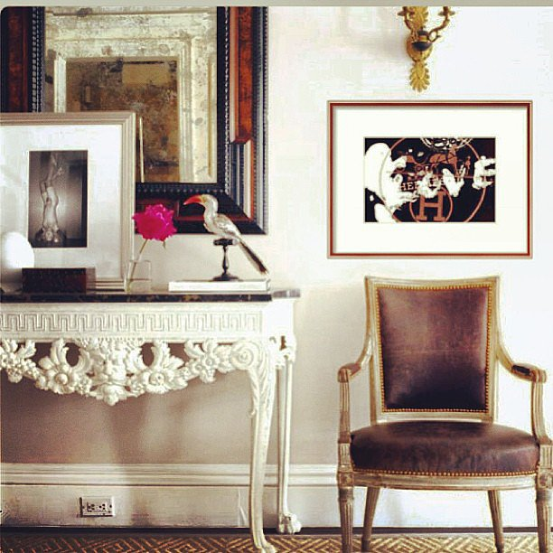 The mirror in this foyer complements the framed artwork. We love the idea of leaning a piece of art against a hanging mirror for a layered effect. Source: Instagram user courtneycachet