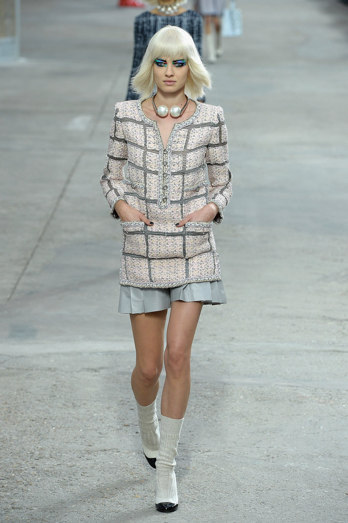 Miranda Kerr walked in the Chanel Spring 2014 fashion show.