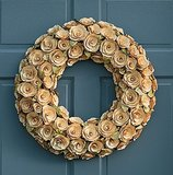 A wreath versatile enough for a range of decorating aesthetics, this ivory Cream Curled Wood Wreath ($45) will warm your door with a delicate yet daring look.