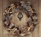 The combination of earthy pinecones and miniature antlers on this Faux Antler Wreath ($99-$199) makes for easy Autumn decor for your front door or patio.