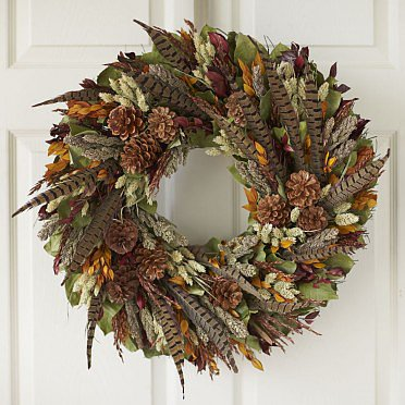 Full of seasonal colors, this Autumn Forest Wreath ($119) looks like it was made by foraging for treasures during a walk through the forest.