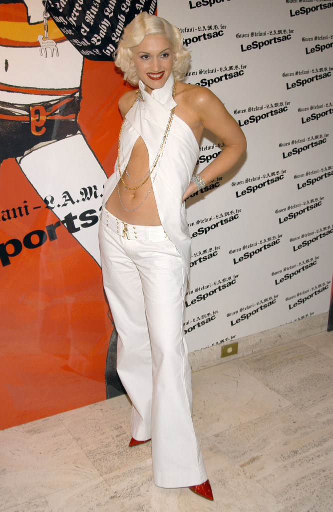 For the L.A.M.B. x LeSportsac 2003 unveiling, Gwen put her famous abs on display in a monochrome ensemble accessorized with fiery red pumps.