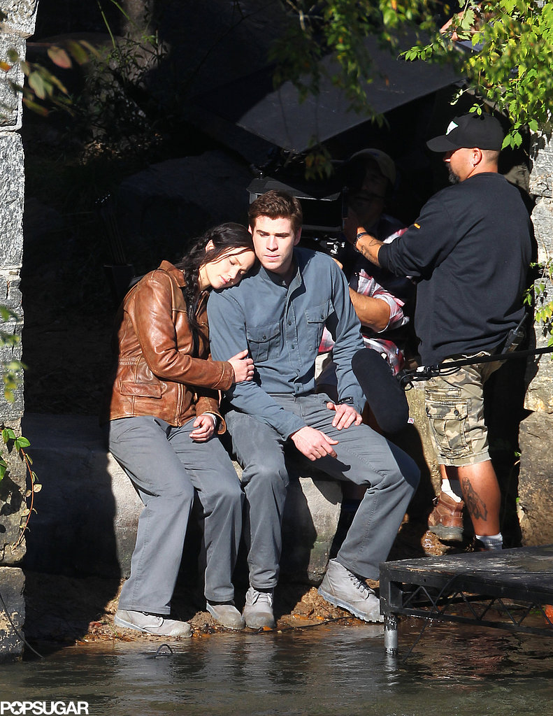 Jennifer Lawrence put her head on Liam Hemsworth's shoulder while filming a scene for Mockingjay.