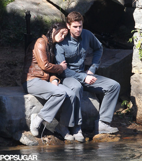 Jennifer Lawrence and Liam Hemsworth cuddled up while filming a scene together.