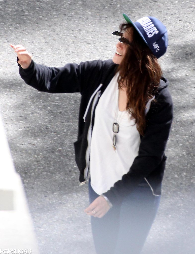 Kristen Stewart flipped up her specs and gave a wave.