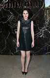 Michelle Dockery wore a black leather dress for Wednesday's Miu Miu show.