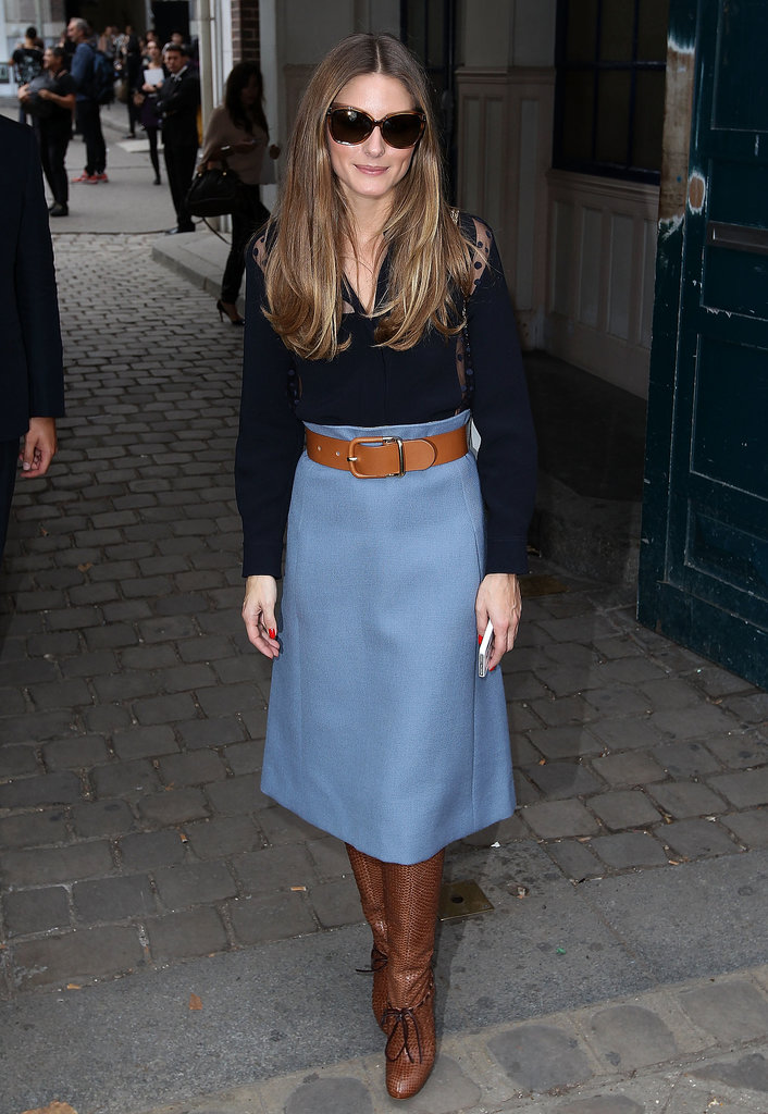 Olivia covered up for Chloé in her blue midi skirt, which was perfectly complemented by her snakeskin boots.